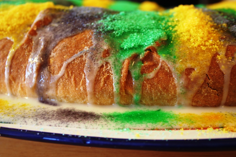 King Cake freshly iced and sugared